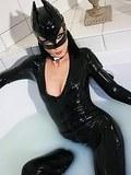 Cat Bitch enjoys a milky wank in her rubber.