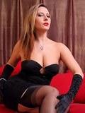 Busty MILF spreads luxury legs in classy black stockings