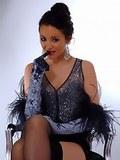 Sultry brunette Rachael B looks elegant in eveningwear, black basque and soft nylon stockings.