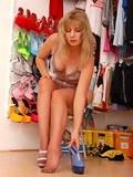 Angel at wardrobe in sheer brown stockings