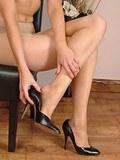 Stunning and slender blonde wearing see through pantyhose