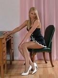 Sexy secretary in shiny pantyhose and white stilettos