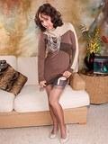 Brunette milf in white lingerie and fine stockings