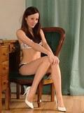 A slender brunette wearing a sexy set of high heels