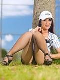 Sporty brunette milf teasing pantyhosed legs