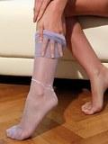 Leggy milf Larissa in purple reinforced stockings