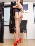 Elegant brunette in vintage lingerie and fine nylon stockings