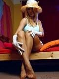 Tempting vintage blonde shows beautiful legs in sheer stockings