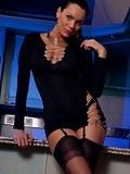 Sweet leggy brunette in thin vintage nylon stockings