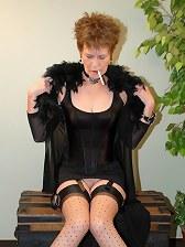 Mature smoking in stockings