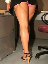 secretary in stockings flashing her panties