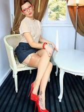 Horny secretary in nylons teases
