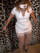 Slutty nurse in stockings gives blowjob