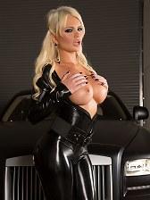 Alexis Ford in black vinyl sucks some horny cocks