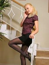 Karen wearing some mini black shorts with black pantyhose