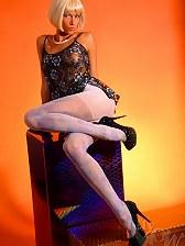 Beautiful leggy MILF in coloured pantyhose