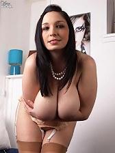 Huge breasted MILF gets her jugs encased in nylon stockings!