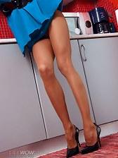 Sexy MILF legs in thin nude pantyhose