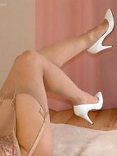 Busty blonde in white stilettos