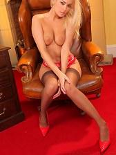 Stunning blonde secretary Natasha Marley shows off her sexy body.