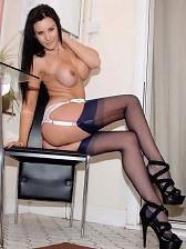Leggy brunette in black stockings