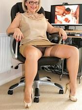 Mature secretary Michelle in fine stockings