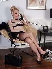 Under cover underwear agent Michelle awaits her secret call!