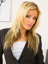 Beauty secretary in miniskirt and satin lingerie.