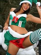 Beautiful Santa Claus shows a sexy strip.