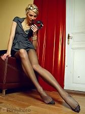 Truly longest and sexiest female legs in sheer black pantyhose!