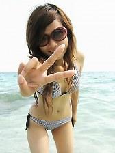 Sexy Asian ex-girlfriend posing in a bikini outdoors