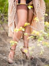 Cute mature Roni upskirting her nyloned legs
