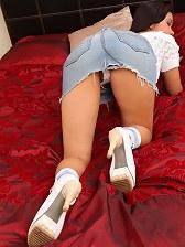Jasmin in the bedroom in white top